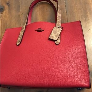 NWT Coach logo Charlie Carryall in leather